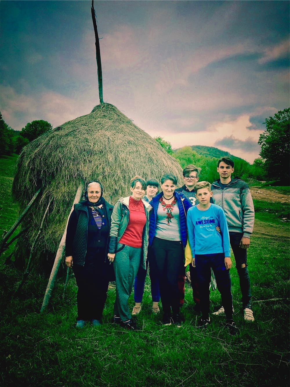 Young farmers helping with the sheeps in Cupseni, Romania