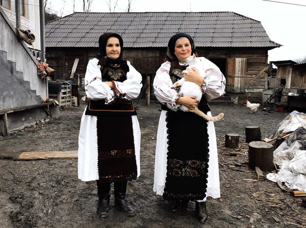 Photographer and storyteller visiting Doina singers in the village of Agries, Transylvania.
